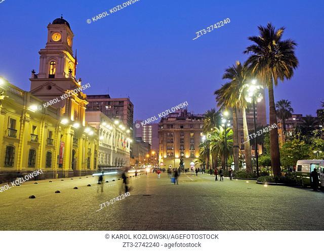 Chile, Santiago, Plaza de Armas, Twilight view towards the Royal Court Palace housing National History Museum