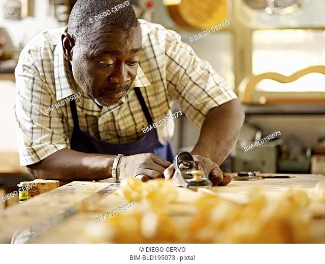 Black craftsman working in workshop