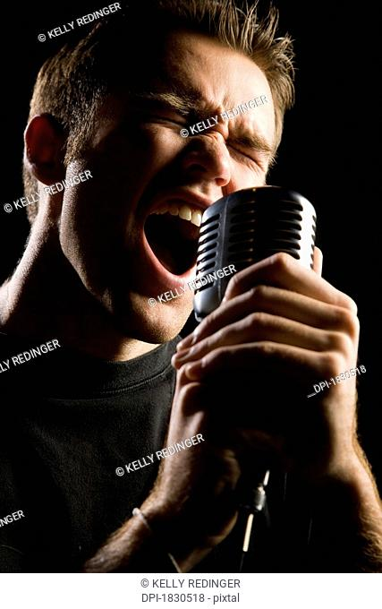 Man singing in a microphone