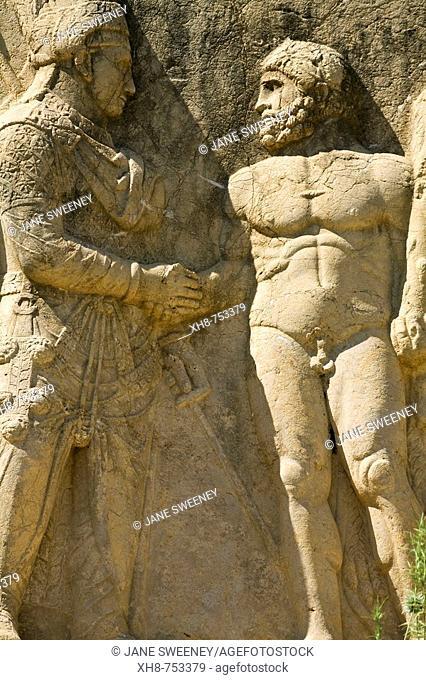 Turkey, Anatolia, Nemrut Dagi National Park, Eski Kale ('Old castle') the ancient Commagene capital of Arsameia, Stone relief of Mithridates I shaking hands...