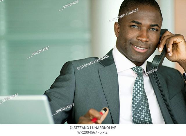 Attractive businessman on the phone, copy-space