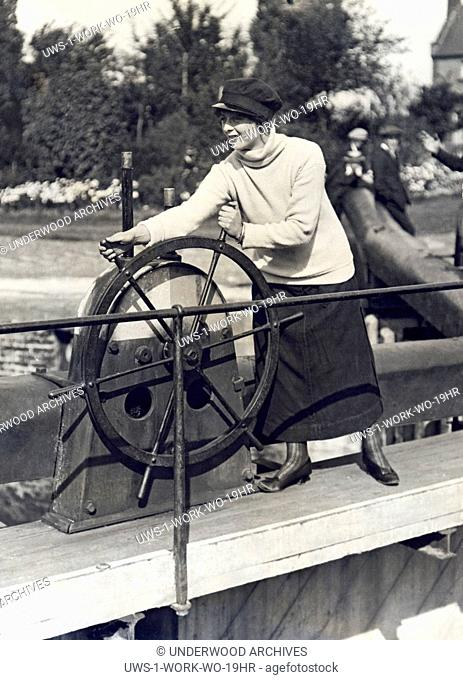 England: c. 1925 A woman operating one of the locks on the River Thames