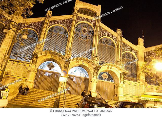 Facade of the modernist Mercat Central market at night. Valencia, Spain