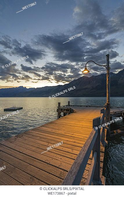 The jetty with lamp post at dusk. Glenorchy, Queenstown Lake district, Otago region, South Island, New Zealand