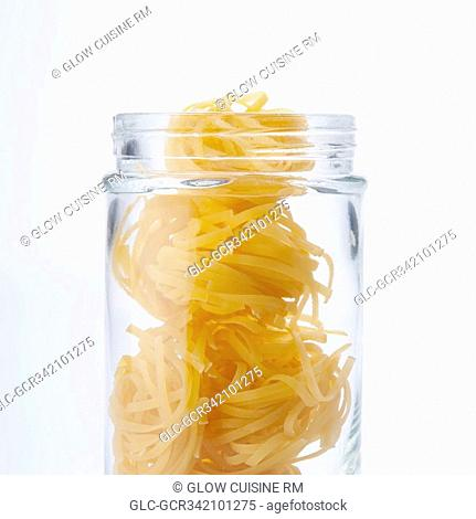 Close-up of uncooked pappardelle pasta in a jar