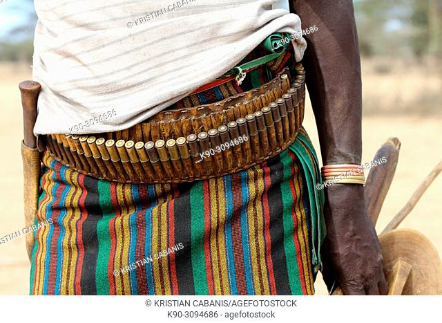 Sheppard from Karo tribe wearing a belt with amunition, Ethiopia, East Africa