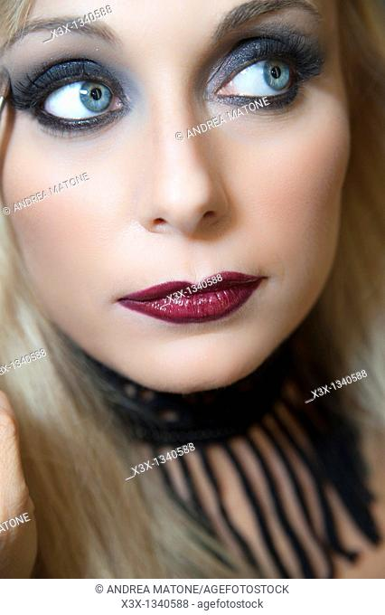 Woman model with makeup looking away