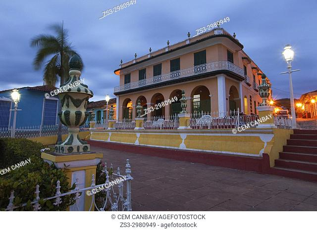 View to the Museo Romantico-Romantic Museum from the Plaza Mayor by night, Trinidad, Sancti Spiritus, Cuba, West Indies, Central America