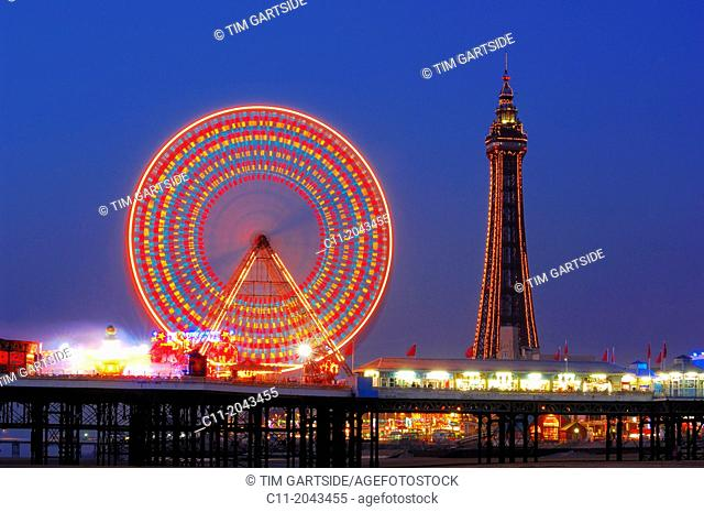 central pier, close up ,detail shot, of ferris wheel at night, reflected in water, on beach, blackpool ,lancashire, england, uk, europe