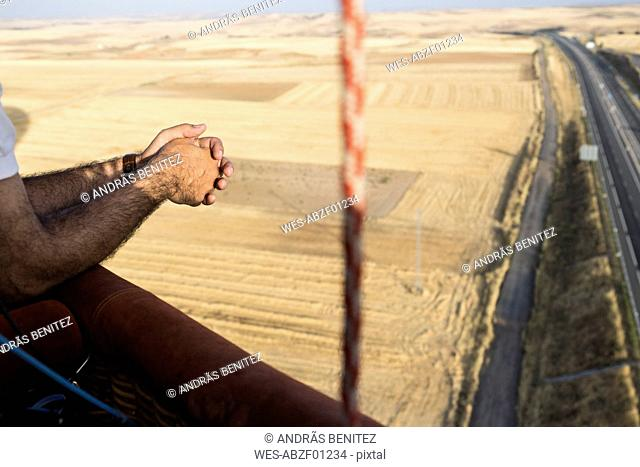 Hands of a man during a hot air balloon trip
