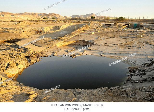 One of the so-called sink holes on the shore of the Dead Sea, undergound collapse caused by the water recession, near Safi, Jordan, Middle East, Orient