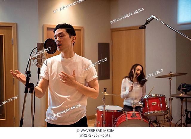 Man singing in studio