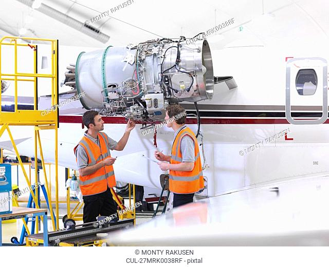 Engineers with jet engine