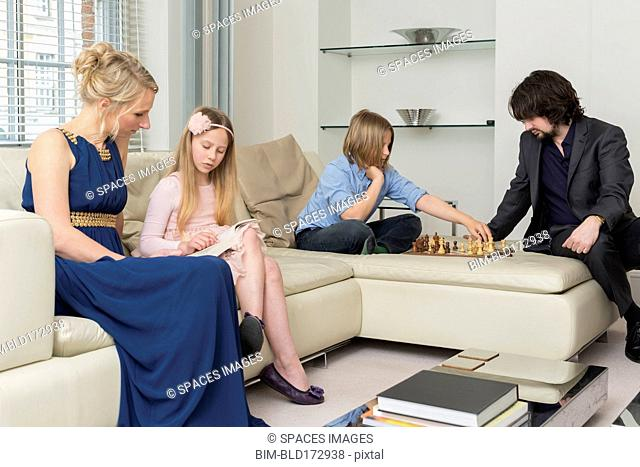 Caucasian family relaxing in living room