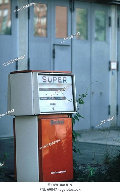 Old petrol pump at gas station, Germany