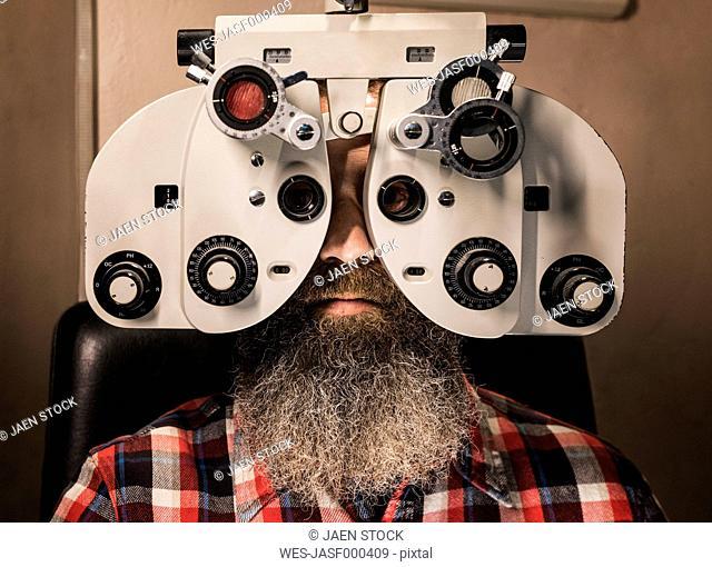 Bearded man making an eye test
