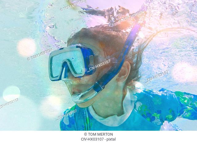 Close up girl snorkeling underwater
