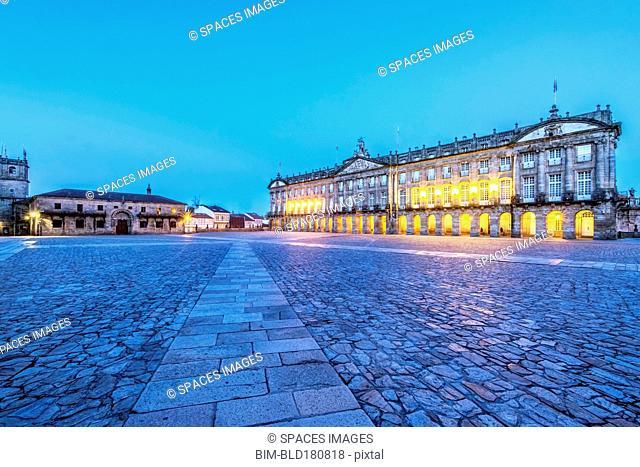 Ornate buildings over cobblestone plaza, Santiago de Compostela, A Coruna, Spain