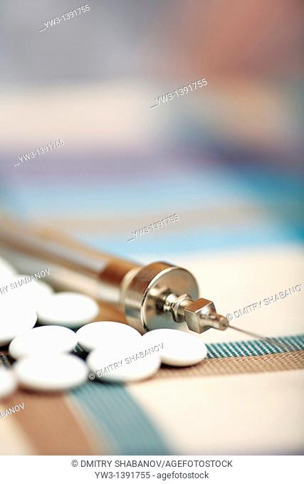 syringe and vial of medication on a the table
