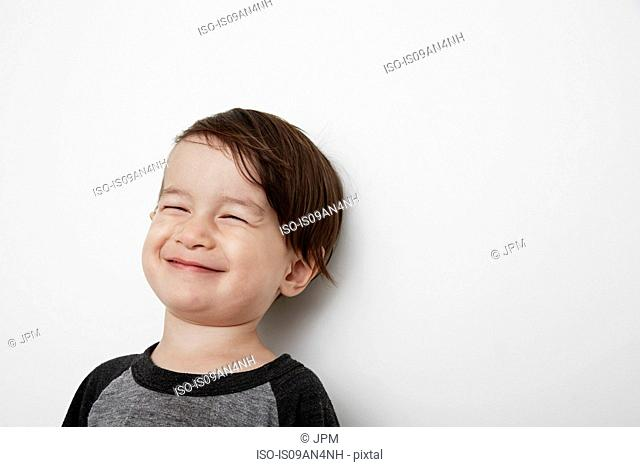 Portrait of male toddler smiling with eyes closed