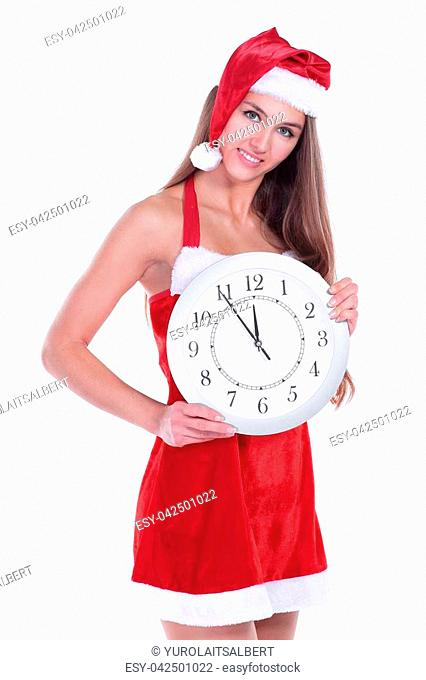 closeup.beautiful young woman in Christmas costume with the large clock.isolated on white.photo with copy space