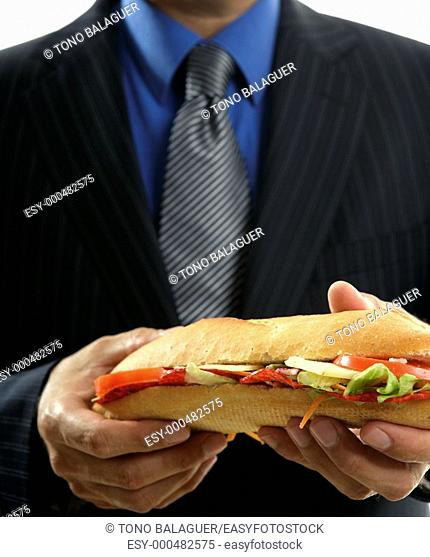 businessman eating junk fast food, studio white background
