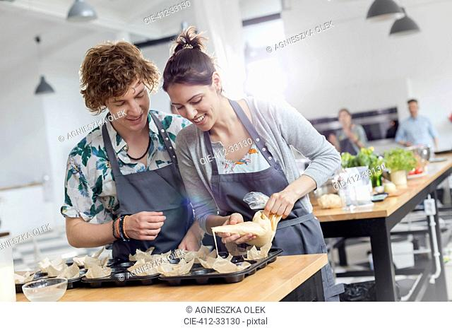 Couple enjoying cooking class in kitchen