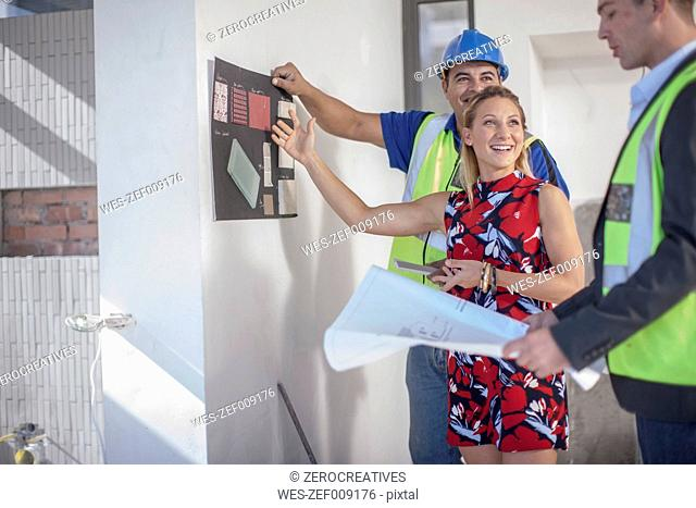 Architect, construction worker and smiling woman