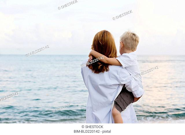 Mother and son admiring ocean