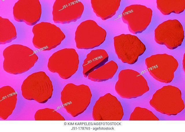 Red Valentine heart candies, one broken