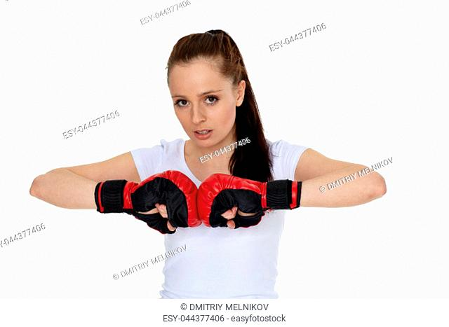 Sporty young woman in red fighting gloves on a white background