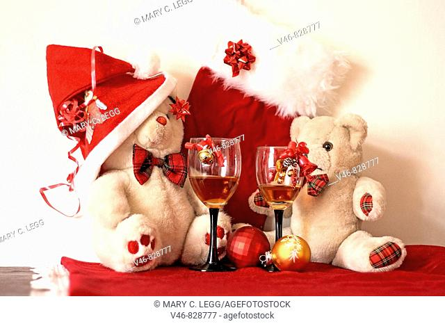 Two white Teddy Bears celebrate Christmas  Mr Fatso teddy Bear celebrates Christmas with his friend Erasmus with a drink on the house in black stemmed wine...