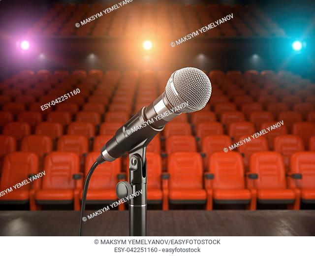 Microphone on the stage of concert hall or theater with red seats and spot light. 3d illustration