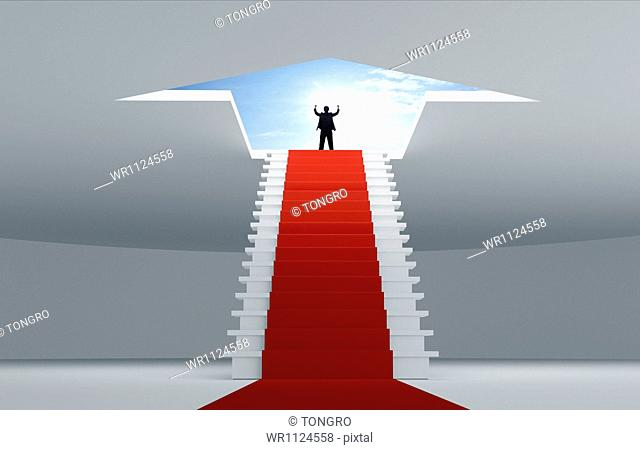 a business man standing on top of the stairs