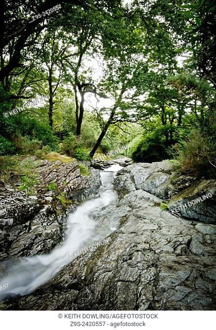 Mountain freashwater stream spills over rocks in County Down's Mourne Mountain National Park Northern irleand. One of Irelands places of outstanding natural...