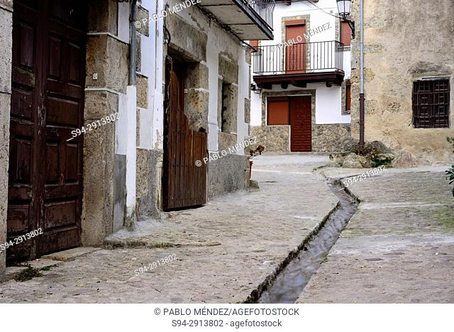 Rustic street with a canal of Candelario, Salamanca, Spain