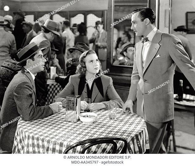 Richard Whorf, Deanna Durbin, Gene Kelly in 'Christmas Holyday'. From the left, American actor Richard Whorf and Canadian actress Deanna Durbin sitting at a...