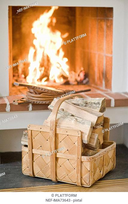 Firewood in front of a fire, Sweden