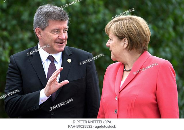 German chancellor Angela Merkel greets Guy Ryder, president of the International Labour Organization (ILO) at the beginning of the outreach conference at Elmau...