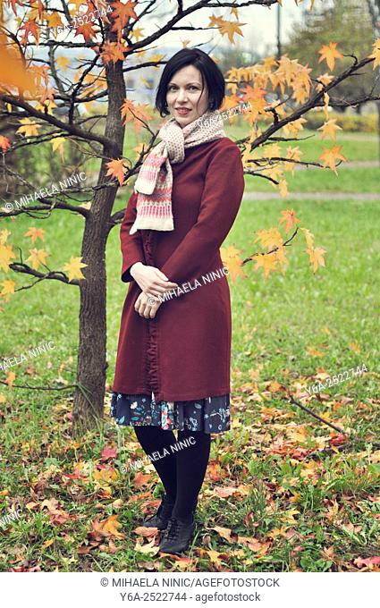 Smiling mid adult woman portrait, autumn