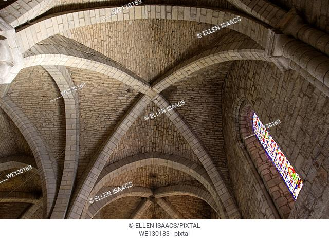 Stone arches support the ceiling of the Basilica of St-Sauveur in Rocamadour, France