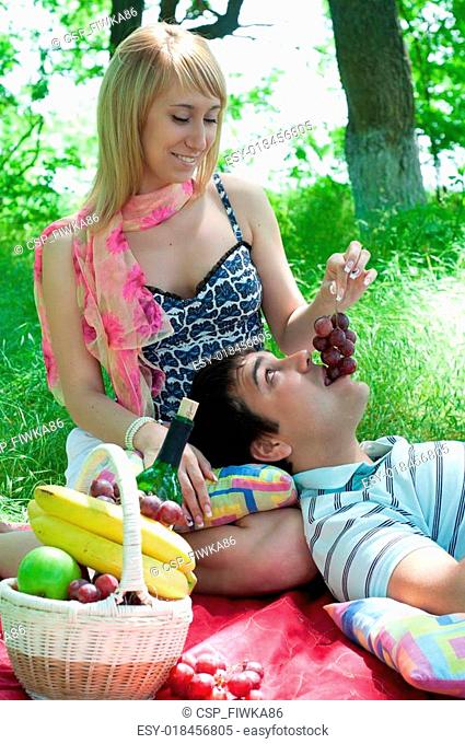 the young couple has a rest outdoors