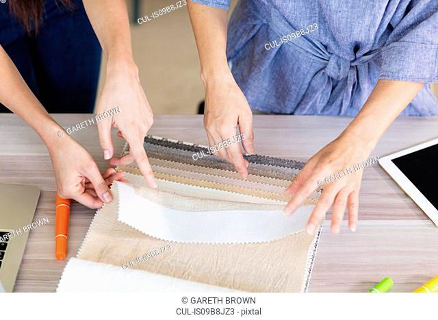 Colleagues working with fabric swatches