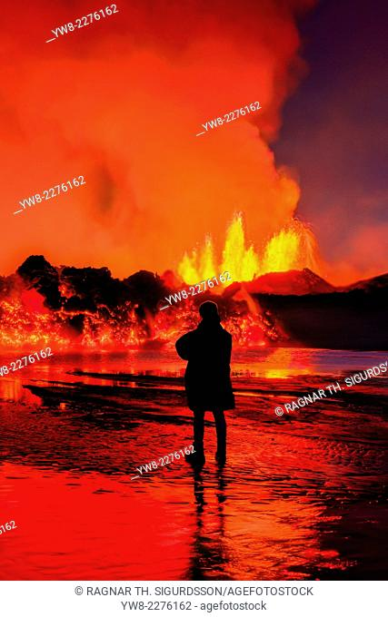 Woman watching the lava flow at the Holuhraun Fissure eruption near Bardarbunga Volcano, IcelandAugust 29, 2014, a fissure eruption started in Holuhraun at the...