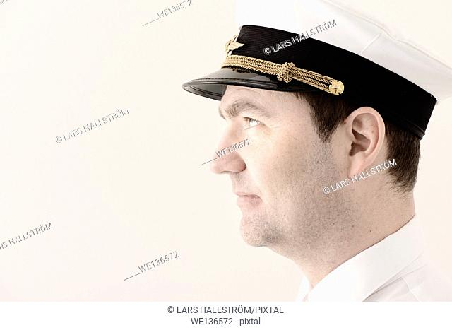 Portrait of man in pilot hat looking away