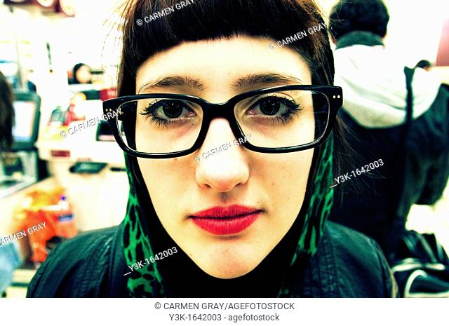 close up of the face of a girl with glasses