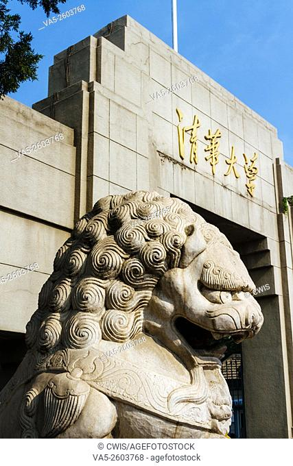 Beijing, China - Close up of the gate of Qinghua university with stone lion in the daytime