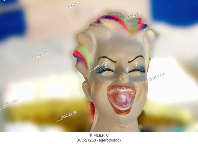 head of a laughing plastic doll