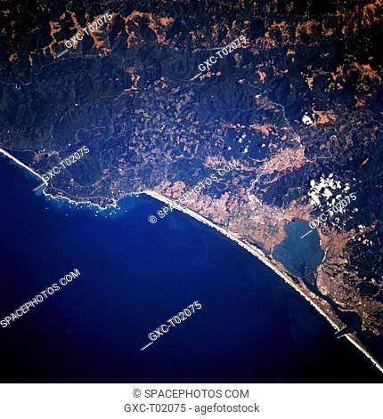 Humboldt Bay, an inlet of the Pacific Ocean, extends northeastward to the coastal plain city of Arcata in this near-vertical photograph