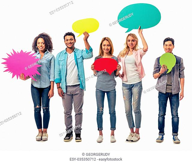 Young people of different nationalities with speech bubbles are looking at camera and smiling, isolated on white background